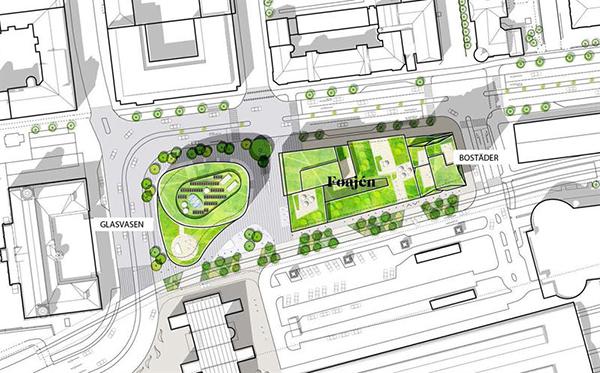 Nederst på bilden syns det nya stationshuset och spårområdet.