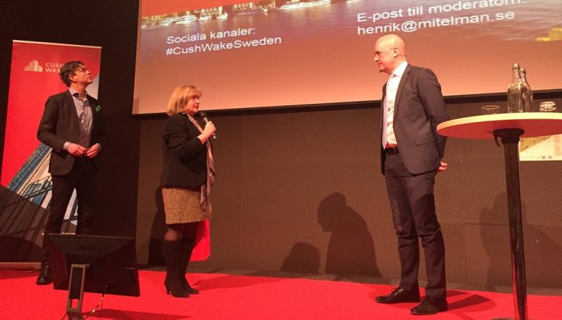 Agneta Jacobsson, VD vid Cushman & Wakefield Sverige, och Fredrik Reinfeldt.